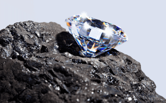 Large diamond sitting on a rock outside