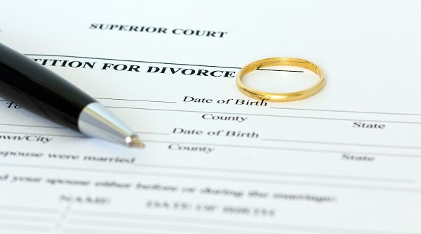 Petition for divorce paper with a pen and wedding ring