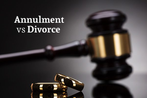 "Two wedding rings with a gavel in the background below the words ""Annulment vs Divorce"""