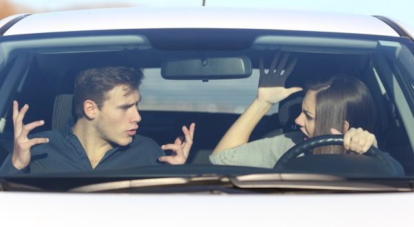 A couple arguing in a car.