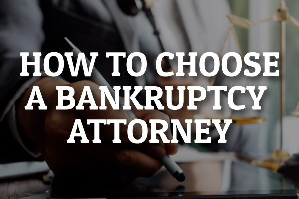 "An attorney talking with a client with the words, ""how to choose a bankruptcy attorney."""
