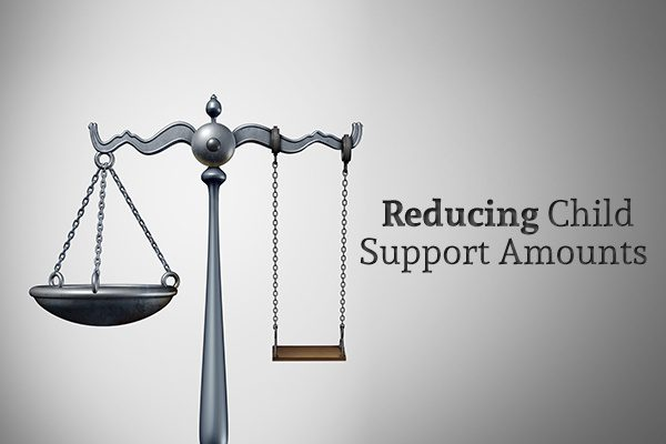 "A Justice scale with one of the scales replaced with a swing beside the words ""Reducing Child Support Amounts"""