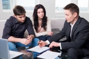 A couple reviews estate planning options with an attorney