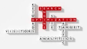 Crossword puzzle showing search engine optimization keywords as dice on a white board flat design SEO concept 3D illustration