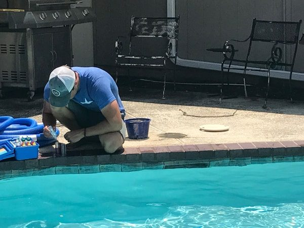 Beautiful pool being cleaned