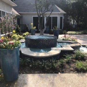 A beautiful fountain in a backyard.