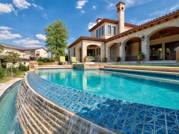 A gorgeous new pool with beautiful pool tiles.