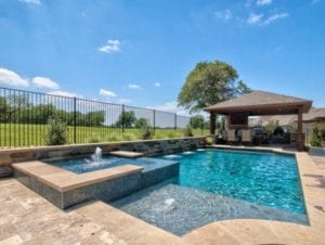 Beautiful outdoor pool, spa, and outdoor kitchen.