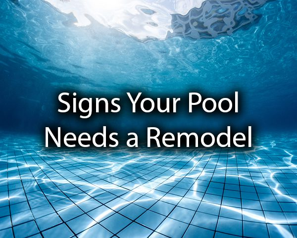 "A gorgeous swimming pool with the words, ""signs your pool needs a remodel."""