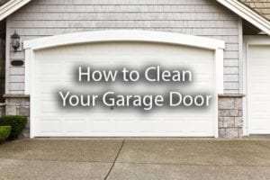 A gorgeous white garage door with the words, how to clean your garage door.