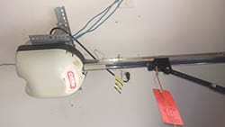 Action Garage Door was called to a Denton Texas home to repair or replace this broken garage door opener and installed a new one