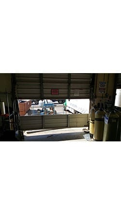 Action Garage Door was summoned to the Culligan plant in Richardson Texas to repair, install, and replace a commercial overhead garage door panel