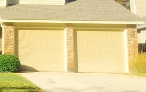 Cream colored two single garage doors in Grapevine Texas repaired by professionals at Action Garage Door