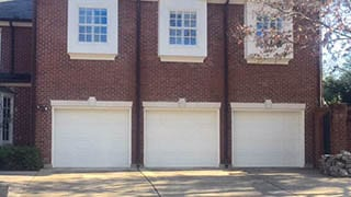 The professional single car steel garage doors installed and repaired in Highland Park Texas by Action Garage Doors technicians of Plano Tx
