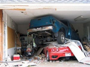 destructive garage door accident involving two vehicles