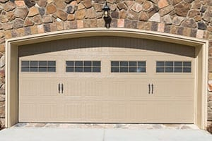 Residential and commercial wooden, steel, and aluminum garage doors installed, repaired, and serviced by professionals from Action Garage Doors of Pflugerville Texas a suburb of Austin