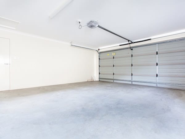Empty double garage with automatic door
