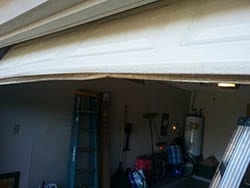 This home located in Garland Texas had a garage door panel and seal in need of being repaired or replace by Action Garage Doors technicians