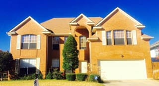 Action Garage Doors is the Grapevine Texas area professional at repair and install of double car steel garage doors by Adan Vega