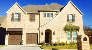 A beautiful install and repair of two custom single car wood garage doors on this residential home in Grapevine Texas by Action Garage Doors