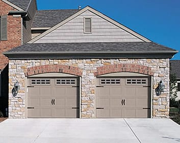 Southlake Tx custom residential steel garage doors and opener being repaired then installed and serviced by Action Garage Doors Plano