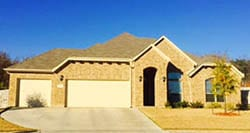 This beautiful home in Lake Worth Texas was serviced by Action Garage Doors for install and repair of steel garage doors