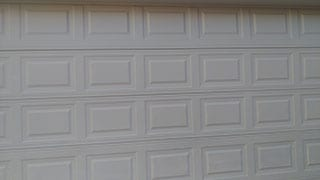 Brand new installed and repaired steel garage door at the residential home 1324 Parkview Ln Murphy Texas by Action Garage Doors