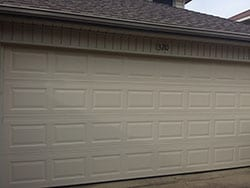 After Action Garage Door did their initial inspection at this home in Lewisville Texas they replaced the old broken down garage door with a new one
