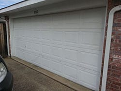 The finished product of Action Garage Doors repairing the broken garage door panel by installing and repairing it in Rockwall Texas