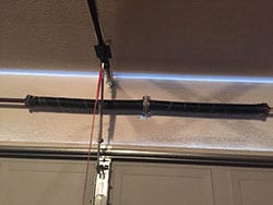 Action Garage Door was summoned to this residence in Richardson Texas because of the garage door opener spring broke and needed to be replaced