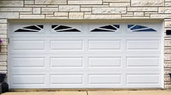 Residential and commercial steel garage doors installed by Action Garage Doors of Leander Texas. They also repair install wood garage doors in the local area