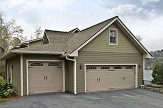 Residential double and single car garage doors repaired and installed by Action Garage Doors of Saginaw Texas a suburb of Dallas and Fort Worth