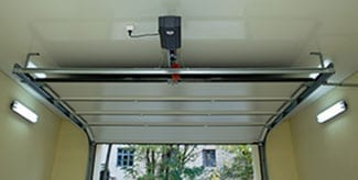 Residential and commercial automatic garage door opener installed by Action Garage Doors of Coppell Texas. Additionally they service, repair, and maintain garage doors in the Dallas Fort Worth area