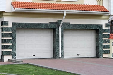 Residential steel and wood garage doors repair, install, service, and maintenance by background checked professionally trained technicians in Irving Texas Action Garage Doors