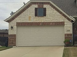 Action Garage Doors installed this beautiful custom steel garage door and repairs as well in the Waxahachie Texas area