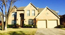 At this residential home in Grapevine Texas technician Alfredo Dinnerville installed and repaired two single car steel garage doors
