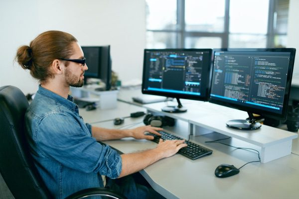 A man working at a computer.
