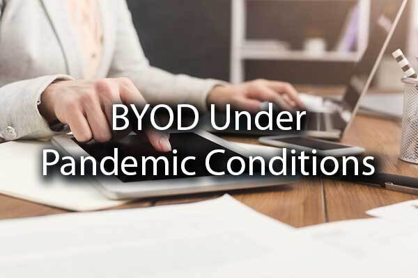 "A person working on a laptop and a tablet with the words, ""BYOD Under Pandemic Conditions"""