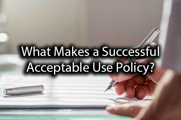 "A person signing a document with the words, ""What Makes a Successful Acceptable Use Policy?"""