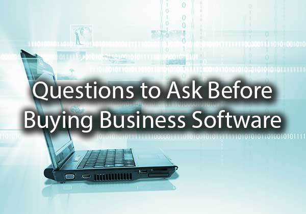 "A computer set up with the words, ""questions to ask before buying business software."""