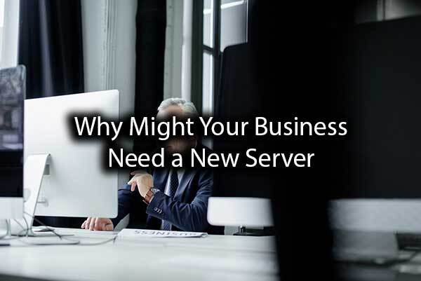 "A man working on his computer with the words, ""Why Might Your Business Need a New Server?"""