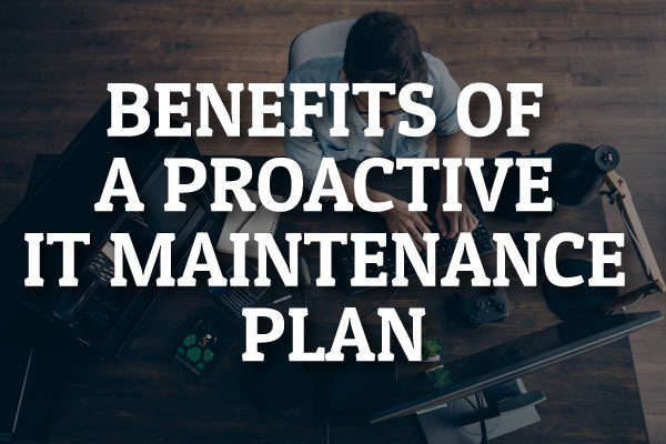 "A man working at his computer with the words, ""benefits of a proactive IT maintenance plan."""
