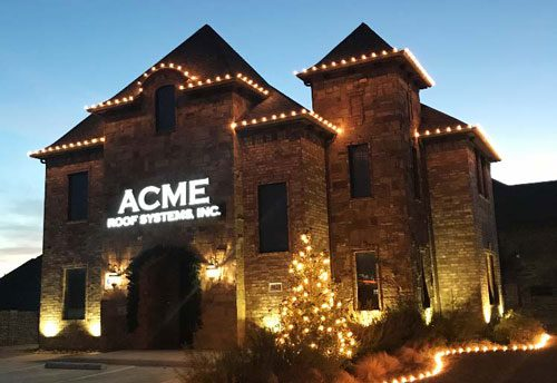 Acme Roof Systems office building at dusk