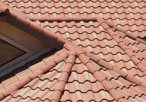 Stone coated steel tiles on a roof
