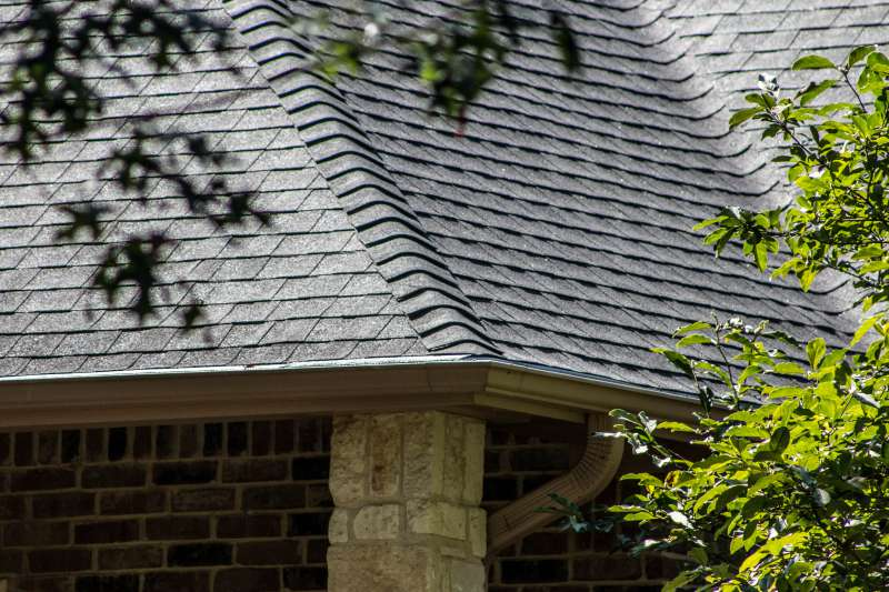 Close-up of a new roof with well-placed shingles.