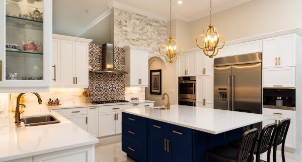 A beautiful shot of a renovated kitchen with a brand new island.