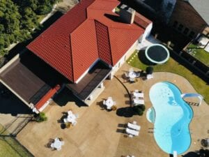 Drone view of read clay tile roofing