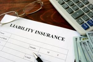 A pen rests on an empty liability insurance claim