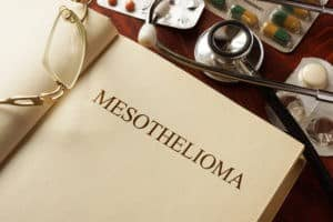 A medical book open to a chapter on Mesothelioma