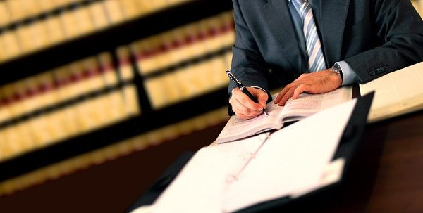 An Attorney takes notes during a consultation with a new client